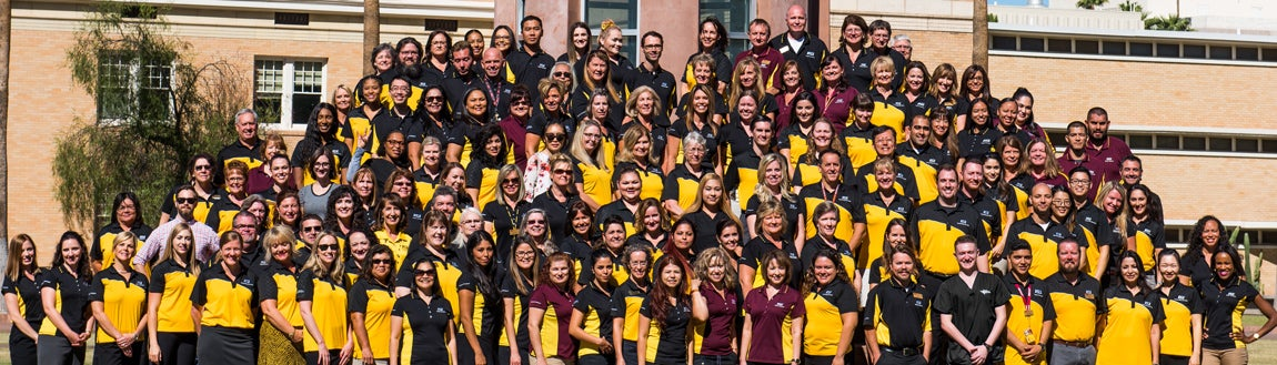 Group photo of 100 + ASU health staff providers in school colored attire of gold, black and maroon.