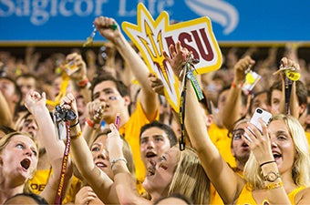 Students in the Inferno section at Sun Devil Stadium cheer on the football team