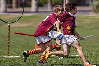ASU students playing intramural quidditch
