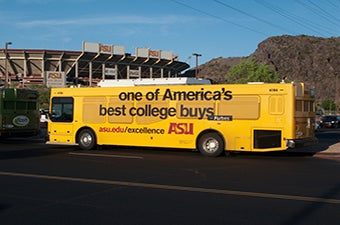 Gold ASU bus in front of the ASU stadium