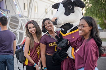 Students wearing maroon and gold during Programming and Activties Board Devils on Mill event