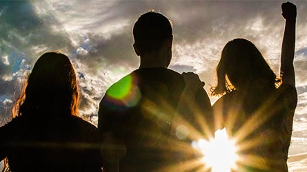 silhouette of 3 students