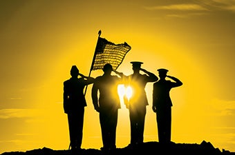 Silhouette of four soldiers with flag