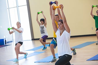 Several students exercising in gym class