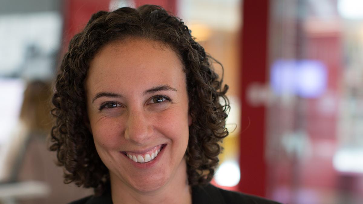 Audrey Handelman smiles for an close up portrait photo