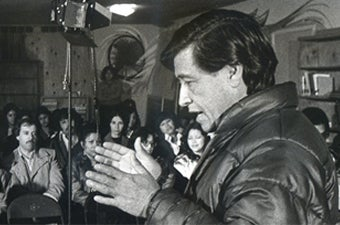 César Chávez speaking to supporters during a gathering