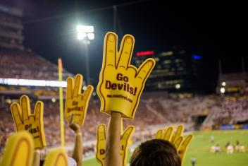 Go Devils foam hand at a football game