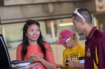 A individual speaking with an ASU health representative.
